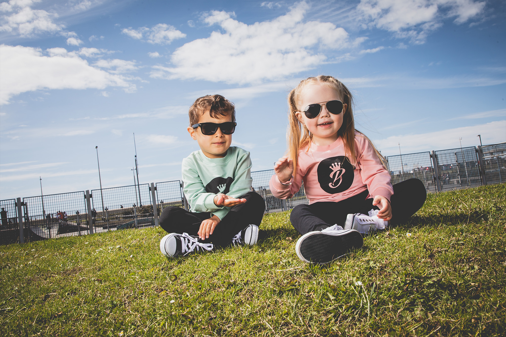 Kids sitting on grass